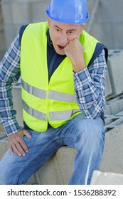 a disappointed senior construction worker