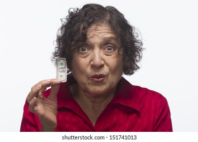 Disappointed woman holds money, horizontal
