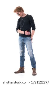 Disappointed young handsome redhead man fashion model looking down pensive. Full body isolated on white background.