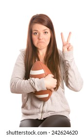 Disappointment - This is an image of a cute female football fan who is sad that her team just lost the game. Shot on an isolated white background.
