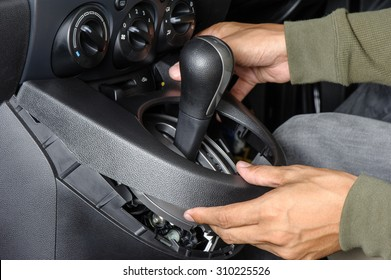 disassemble the center console of the car