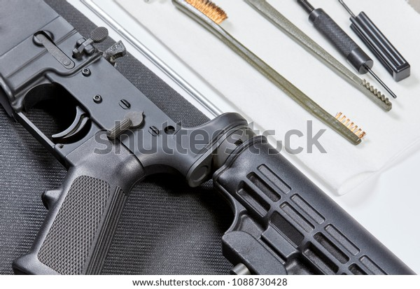 Disassembled AR-15 Rifle in preparation to clean it