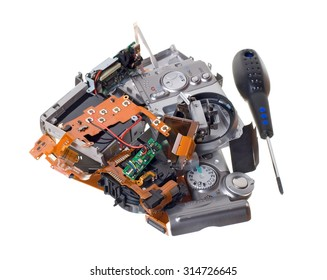 Disassembled broken compact digital camera spare parts isolated on white