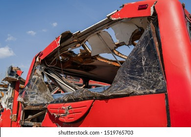 Disassembled bus after the accident used for parts wrecked broken red buses scrap for recycling broken rear window