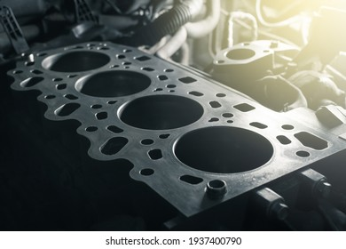 Disassembled car engine without cylinder head. Repair of an old turbocharged diesel engine in a car workshop. Close up.