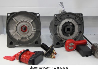 Disassembled car winch - planetary gearbox, motor and control panel