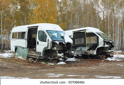 Disassembled cars after the accident in the forest