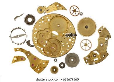 Disassembled clockwork mechanism - various part of clockwork mechanism on white background