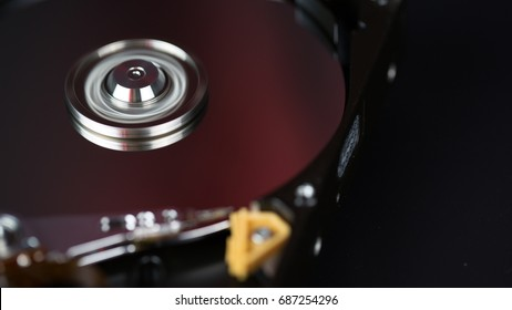 Disassembled hard disk without top cover close up. inside view of HDD. Computer hardware part.