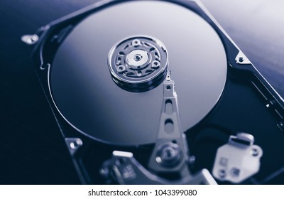 Disassembled hard drive from the computer, hdd with mirror effect. Opened hard drive from the computer hdd with mirror effects. Part of computer pc, laptop