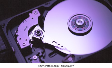 Disassembled hard drive from the computer, hdd with mirror effect Opened hard drive from the computer hdd with mirror effects Part of computer pc, laptop Closeup HDD