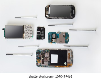 disassembled mobile phone and screwdriver close-up, top view