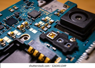 Disassembled mobile phone or smartphone without a back cover, circuit board, microcircuit, slots for sim cards. Macro view