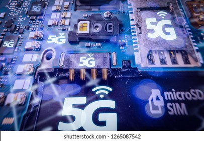 Disassembled mobile phone or smartphone without a back cover, and 5G or LTE word printed in circuit board, microcircuit, slots for sim cards.High speed mobile web technology concept. Macro shot