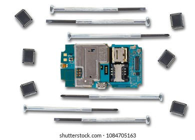 disassembled mobile phone and tools on white background