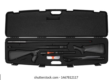 Disassembled modern semi-automatic shotgun in a hard plastic case with soft foam inside. Weapon case isolate on white background.