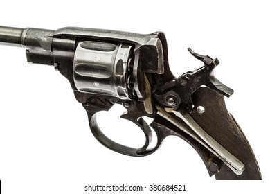 Disassembled revolver, pistol mechanism with the hammer cocked, isolated on white background