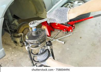 Disassembling car shock absorber, Close up.