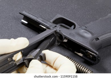 Disassembling a handgun in preparation to clean it