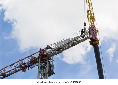 Disassembly of the tower crane with the help of a super large crane at the construction site