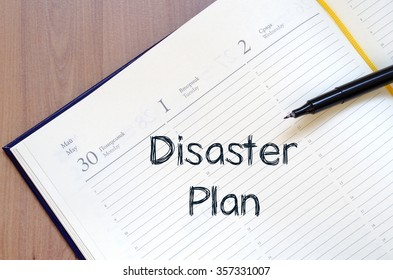 Disaster plan text concept write on notebook with pen