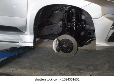 Disc brake car  without wheels in maintenance service.close up.