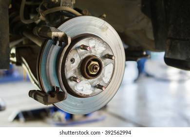 Disc brake on car, in process of new tire replacement,Car brake repairing in garage, automotive service station,mechanic changing a wheel and Tires,Preparing car tire before departure,selective focus