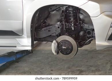 Disc car maintenance in car service center.close up.