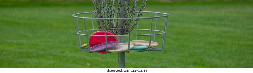 Disc Golf basket full of disc