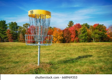 Disc golf hole basket in autumn park