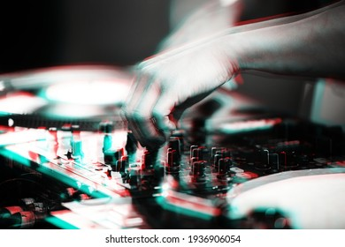 Disc jockey mixing controller on night club party.DJ sound mixer with anaglyph effect.Professional stage audio equipment edited with vintage filter.Download royalty free curated dj images collection