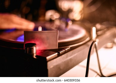 disc jockeys playing in mixing music on turntables and vinyl records