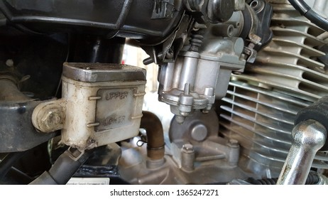 Disc oil, carburetor, and cylinder combustion on a motorcycle. Regular maintenance is needed to keep the engine in good condition when used
