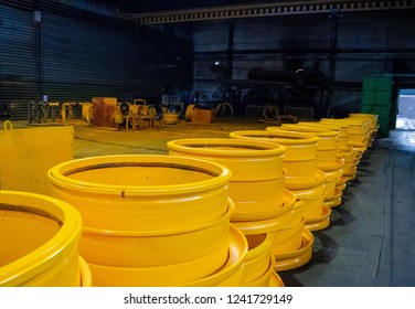 Disc rim production site for BelAZ dump trucks in the forge factory. Machine shop of metallurgical works indoors room.