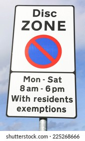 Disc Zone Parking Sign indicating restrictions for parking between a Monday and a Saturday with the exception of residents.