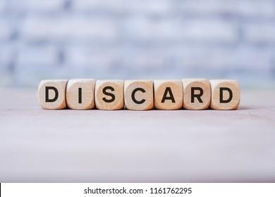 Discard word written on wood block