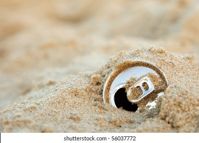 Discarded aluminum can in the sand