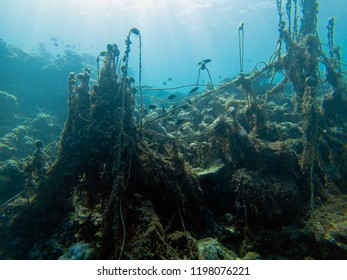 Discarded ghost fishing net causing  damage to a coral reef and their habitat
