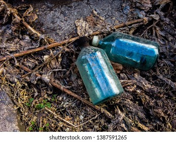 Discarded old bottles in the environment. Pollution. Environmental problem.