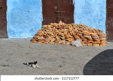 Discarded old breads on a street in Tangier, Morocco