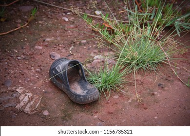 Discarded old shoe on the road