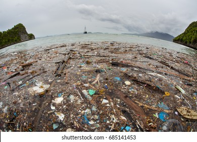 Discarded plastic has washed up near a remote island in Raja Ampat, Indonesia. Plastic is an ever-growing danger to marine ecosystems throughout the world.