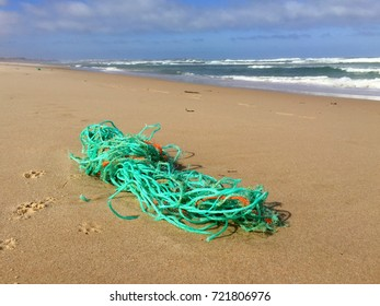 Discarded plastic rope on the beach