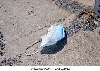 discarded protective non-surgical mask on the pavement in Montreal, during the Covid 19 lockdown