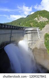 discharge from Kurobe dam with rainbow in Toyama, Japan