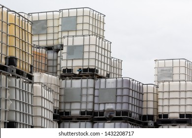 discharge of plastic barrels in warehouse yard.  IBC container in outdoor stock yard of factory.