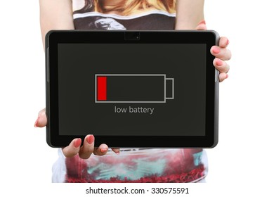 discharged the tablet in the hands of a young and beautiful girl isolated on white background