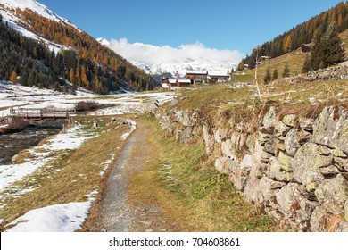 Dischma valley with hiking trail and historical  dry wall in Davos in Grisons (Graubuenden), Switzerland