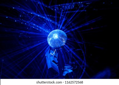 Disco ball with blue bright rays, night party background photo