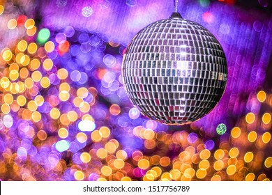 Disco ball with with bokeh defocused lights. Night party background photo. Disco party. Blurred, abstract background. Copy space.